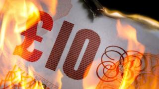 £10 note on fire