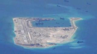 Chinese vessels at work in an aerial view of the Fiery Cross Reef in the South China Sea