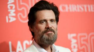 """In this April 18, 2015 file photo, Jim Carrey arrives at LACMA""""s 50th Anniversary Gala in Los Angeles."""