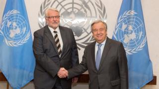 In this photo provided by the United Nations on Monday Jan. 9, 2017, U.N. Secretary-General Antonio Guterres, right, and Poland