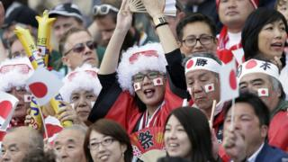 Japanese rugby fans celebrate the 34-32 win against South Africa in Brighton