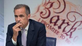 Governor of the Bank of England Mark Carney looks on during a quarterly inflation report press conference