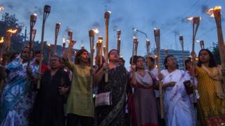 Bangladeshi secular activists participate in a torch rally held to protest against the killing of blogger Niloy Chottopadhay