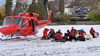 Rescue teams prepare to search for a group of people buried by an avalanche at the Wattener Lizum, Austria, on February 6, 2016