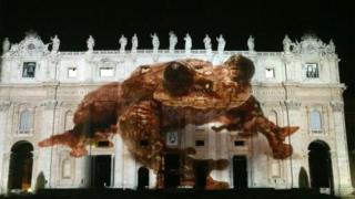 """An image of """"Toughie"""" projected onto the Vatican"""