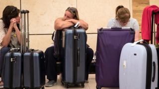 Tourists wait with luggage at Sharm el-Sheikh airport
