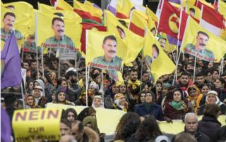 Kurds living in Germany wave flags with portraits of detained Kurdish PKK Leader Abdullah Ocalan in Frankfurt on 18 March, 2017.