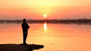 IS image - fishing on the Euphrates
