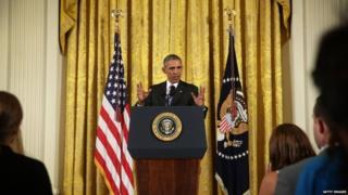 US President Barack Obama speaks during a news conference - 15 July