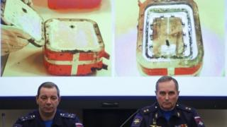 Sergei Bainetov (R), deputy chief of the Russian Armed Forces' flight safety service, and Nikolai Primak, chairman of the Air Accident Investigation Commission, attend a news conference on 21 Dec
