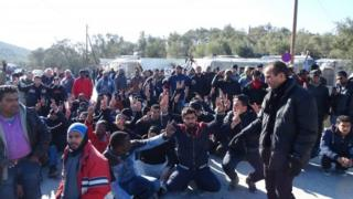 Migrants protest near the Moria camp on Greece
