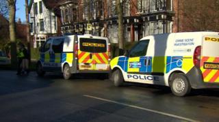 Police vans outside house