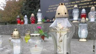 Candles on grave at Gunnersbury Cemetery