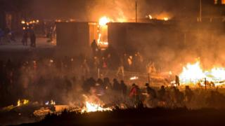 Image result for France migrants: Huge fire guts Grande-Synthe Dunkirk camp