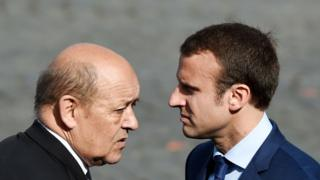 Mr Le Drian (R) and Mr Macron served together under President Francois Hollande