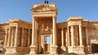 An image allegedly showing a flag of the Islamic State (IS) group flying above a Roman theatre in the ancient city of Palmyra - 17 June 2015