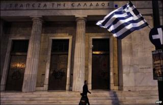 Man walks past Greek Central bank