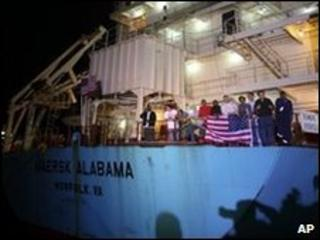 Crew members celebrating on the Maersk Alabama after the captain's release