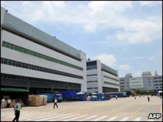 Staff walk at the giant Foxconn complex in Shenzhen, China, on 26 May 2010