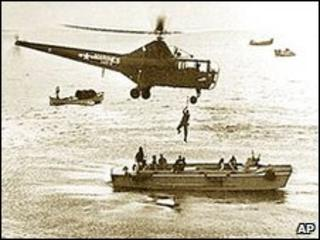 A US Marine helicopter picks up personnel from a landing barge in Inchon Harbour