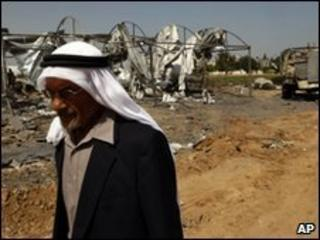 A man walks past bombed out camp in Beit Hanoun