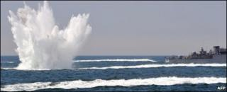 A South Korean patrol boat drops a depth charge during a drill off the western coast town of Taean