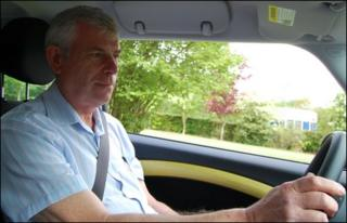 David Beesley drives the Mini E