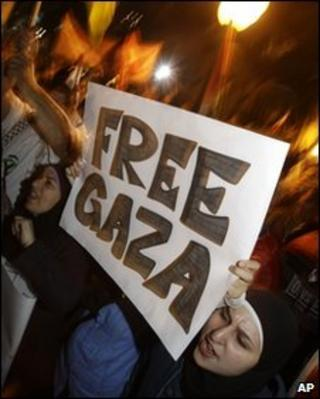 A woman holds a 'Free Gaza' banner in Sydney, Australia