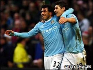 Carlos Tevez and Gareth Barry of Manchester City