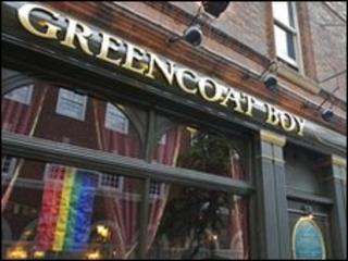 Rainbow flag in pub window