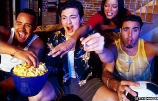 Football fans on the sofa
