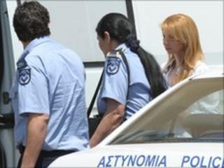 Elena Skordelli is escorted by police after leaving court, 7 June 2010