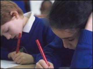 Junior school pupils writing