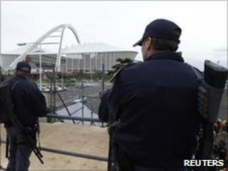 South African police stand at the ready in Durban, June 15, 2010