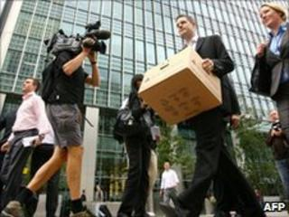 Lehman Bros' London staff leave work after the collapse