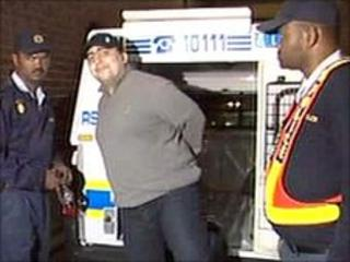 Pavlos Joseph being led out of a police van