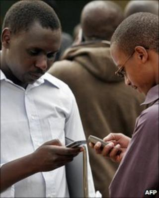 Kenyan men with mobile phones