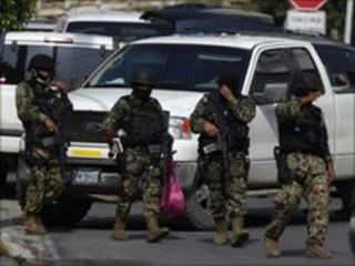 Mexican Marines walk on a street during an operation against organized crime and drug trafficking in a wealthy neighbourhood in Monterrey