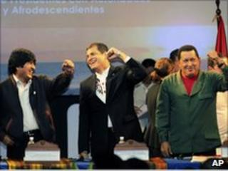 Presidents Morales, Correa and Chavez laughing together at the summit.