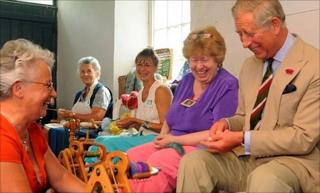 Prince Charles is taught how to spin wool