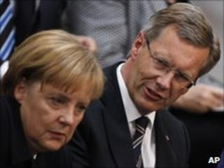 German Chancellor Angela Merkel, left, and Christian Wulff, presidential candidate, in the Reichstag on 30 June 2010