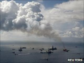Smoke rises from the BP oil spill site, as natural gas is burned off, while the drilling of two relief wells continue in the Gulf of Mexico