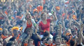 People watch the World Cup semi-final between the Netherlands and Uruguay in Museum Square, Amsterdam, 6 July 2010