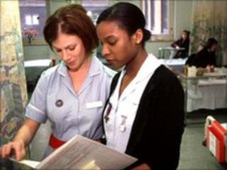 Nurses discussing patient's notes
