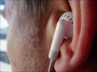 Man listening to music on earphones