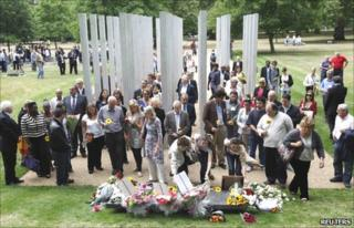 People laying flowers at the Hyde Park memorial