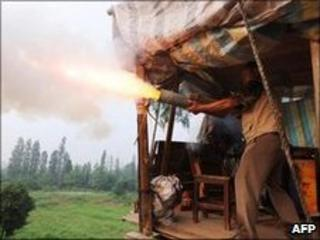 Yang Youde firing home-made cannon from his home in Yuhan, China 6 June 2010