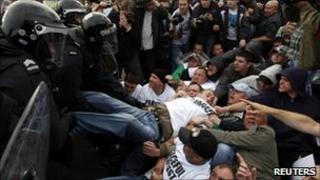 Riot police remove protesters