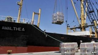 Crates of oil are loaded on to the Amalthea at the Lavrio port in Greece on 9 July, 2010