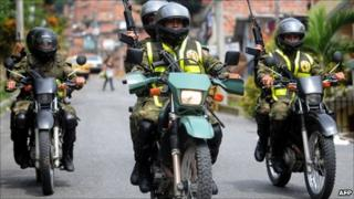 Troops on motorbikes patrol Medellin in photo from 19 June
